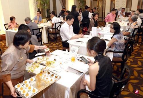 """中國僑網""""中國美食之旅""""晚宴是第五屆亞洲食尊美食盛會的開幕活動。(新加坡《聯合早報》/周國威 攝)"""